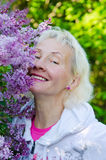 Portrait of a woman from a blooming lilac Stock Photography