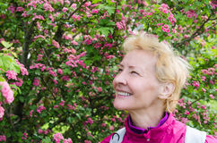 Portrait of a woman in a blossoming hawthorn Stock Images