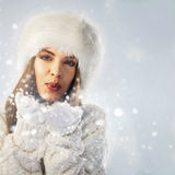 Portrait of a woman blowing snow Royalty Free Stock Photos
