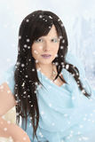 Portrait of woman in blue dress with it snowing Stock Images