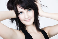 Portrait of a woman with blue eyes and messy hair stock image