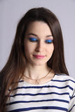 Portrait of woman with blue eyeshadow Stock Photo