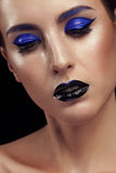 Portrait of woman with blue fashion make up Royalty Free Stock Image