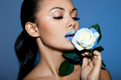 Portrait of woman with blue rose Royalty Free Stock Image