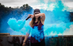 Portrait of woman in blue smoke Stock Photos