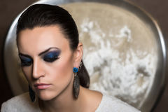 Portrait of a  woman. Portrait of a woman with blue smokey eyes make-up and bijou Stock Photos