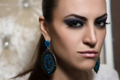 Portrait of a  woman. Portrait of a woman with blue smokey eyes make-up and bijou Royalty Free Stock Photography