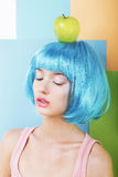 Portrait of Woman in Blue Wig with Green Apple Royalty Free Stock Photos