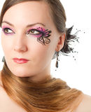 Portrait of  woman with body art butterfly on face Stock Photo