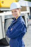 Portrait woman in boilersuit and hardhat Stock Photos