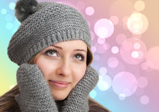 Portrait of woman on bokeh background. Wearing woolen accessories Stock Photo