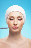 Portrait of a woman on a botox injection procedure Stock Image