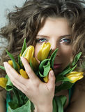 Portrait of woman with the bouquet. Portrait of woman with the bouquet yellow flowers Stock Photo
