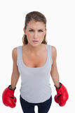 Portrait of a woman with boxing gloves Stock Photos