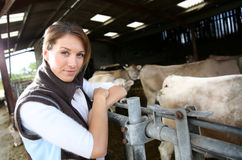 Portrait of woman breeder in barn Stock Images