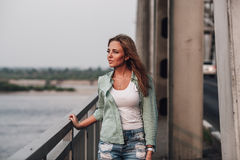 Portrait of woman on bridge Royalty Free Stock Images