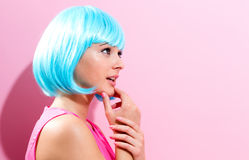 Portrait of a woman in a bright blue wig Royalty Free Stock Photos