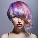Portrait of a woman with bright colored flying hair, all shades of purple. Hair coloring, beautiful lips and makeup. Hair. Fluttering in the wind. girl with stock images