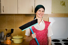 Portrait of Woman with a Broom in the Kitchen Stock Photos