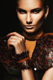 Portrait of woman with brown accessories. In dark Royalty Free Stock Photos