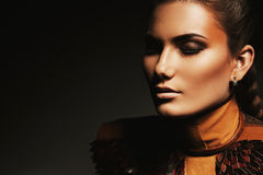 Portrait of woman with brown accessory. In dark Royalty Free Stock Photo