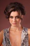 Portrait of a woman brunettes. Purple background Stock Photos