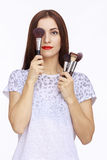 Portrait of woman with brushes Stock Images
