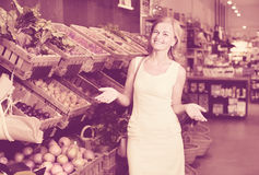 Portrait of  woman buying fresh greens and fruits Stock Photo