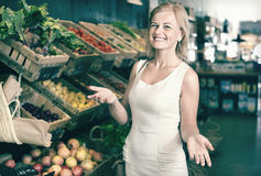 Portrait of  woman buying fresh greens and fruits Stock Image