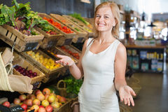 Portrait of  woman buying fresh greens and fruits Stock Images