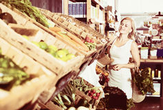Portrait of  woman buying fresh greens and fruits Royalty Free Stock Images