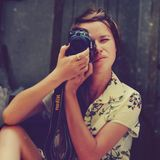 Portrait of woman with camera