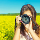 Portrait of a woman with a camera outdoors Royalty Free Stock Images