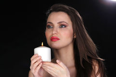 Portrait of a woman with a candle. Royalty Free Stock Images