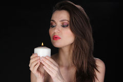 Portrait of a woman with a candle. Stock Photography