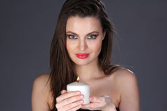 Portrait of a woman with a candle. Royalty Free Stock Image