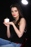 Portrait of a woman with a candle. Stock Photo
