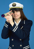 Portrait of the woman - captain with spyglass Stock Photo