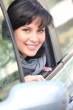 Portrait of a woman in a car Royalty Free Stock Image