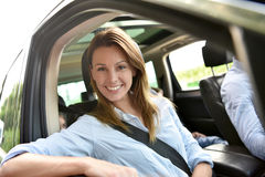 Portrait of woman in a car going for a ride. Portrait of women sitting in car with family Stock Photography
