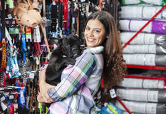 Portrait Of Woman Carrying French Bulldog At Store Stock Photo