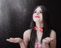 Portrait of a woman catching a white powder Stock Images