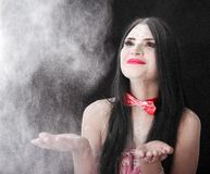 Portrait of a woman catching a white powder Royalty Free Stock Images