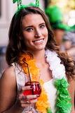 Portrait of woman celebrating St Patricks day. With friends and drinks Stock Photos