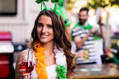 Portrait of woman celebrating St Patricks day. Portrait of women celebrating St Patricks day with friends and drinks Stock Photos