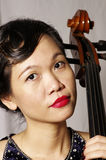 Portrait of woman and cello. Close up of woman and cello Stock Photo