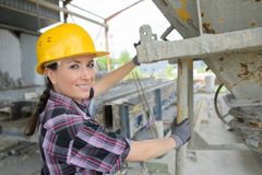 Portrait woman by cement hopper Stock Photo