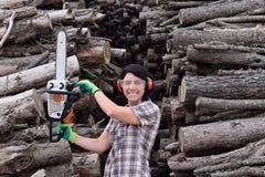 Portrait of a woman with a chainsaw. A portrait of a woman with a chainsaw royalty free stock photo