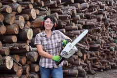 Portrait of a woman with a chainsaw. A portrait of a woman with a chainsaw stock photography