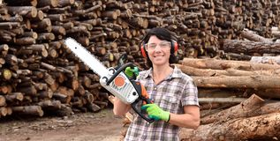 Portrait of a woman with a chainsaw. A portrait of a woman with a chainsaw stock photo